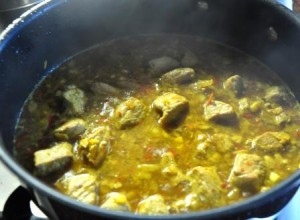 Pork simmering in the pan with curry sauce