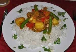 Pork, pineapple and capsicum curry served on rice