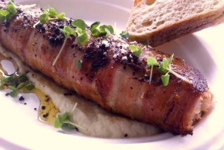 An image of pancetta wrapped rainbow trout