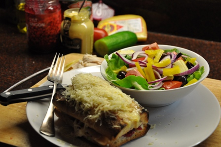 An image of turkey croque-monsieur with salad