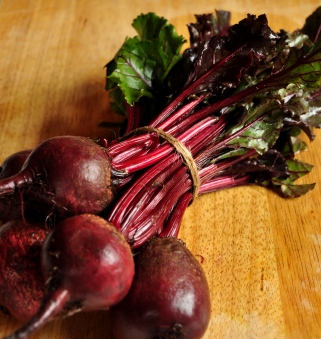 An image of fresh beetroot with leaves