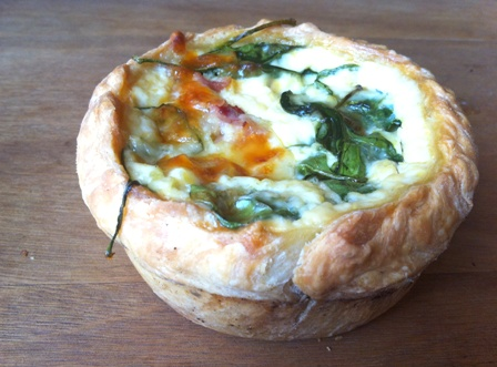 An image of bacon and spinach quiche