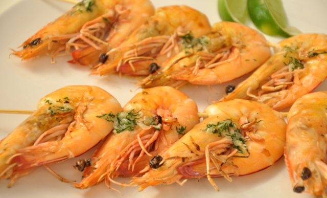 An image of prawns in dill and garlic butter