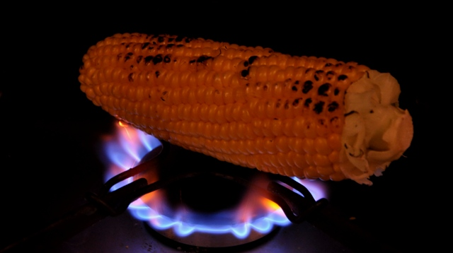 An image of chargrilled sweet corn over gas