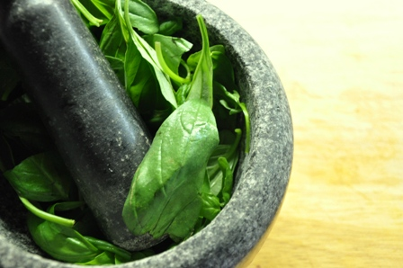 Fresh basil in a pestle and mortar