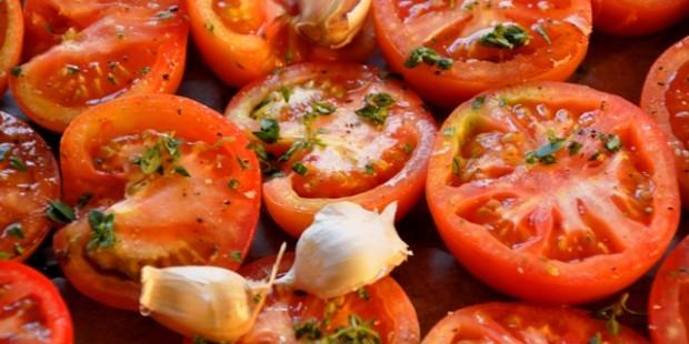Seasoned tomatoes ready for roasting