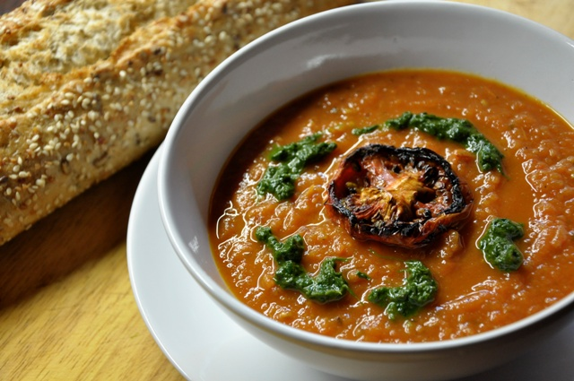 An image of Roasted tomato soup in a bowl with bread