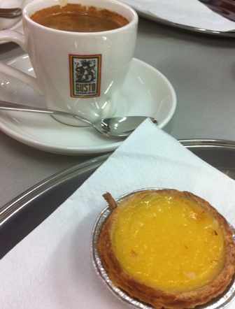 An image of custard tart and coffee
