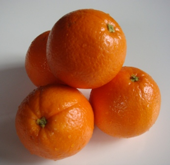 An image of oranges in a stack