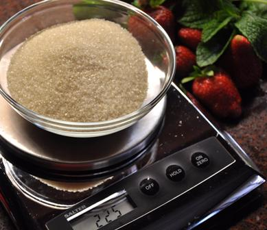 AN image of raw cane sugar on scales.