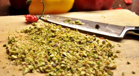 An image of chopped pistachio nuts for stuffed peppers