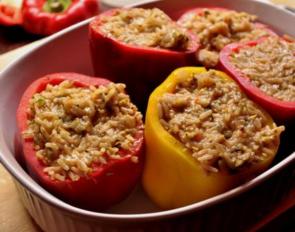 An image Greek style stuffed peppers ready to be roasted.