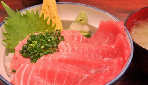 An image of traditional Japanese breakfast of salmon and rice