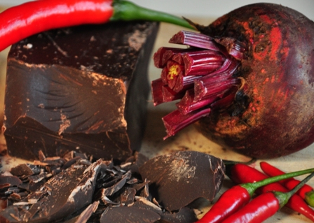 An image of beetroot, chillies and dark chocolate