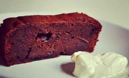 An image of a slice of black forest brownie