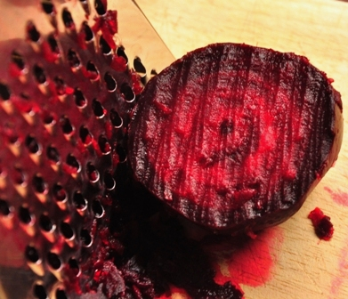 An image of cooked beetroot and a grater