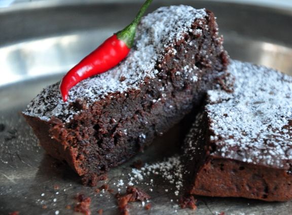 An image of beetroot and chilli chcolate brownies on a metal plate