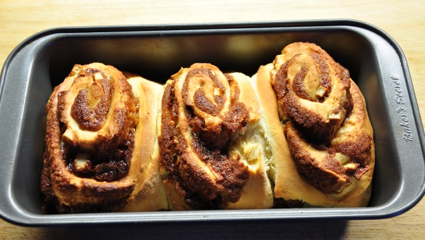 An image of cinnamon rolls in a baking tin
