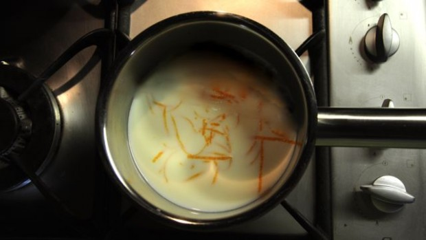 An image of orange zest infusing milk