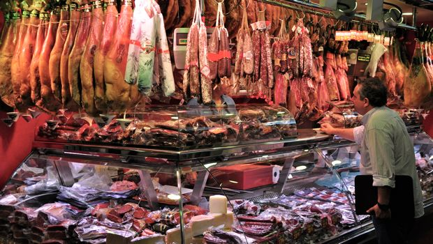 An image of a charcuterie stand at La Boqueria