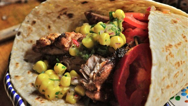 An image of chicken fajitas with corn salsa