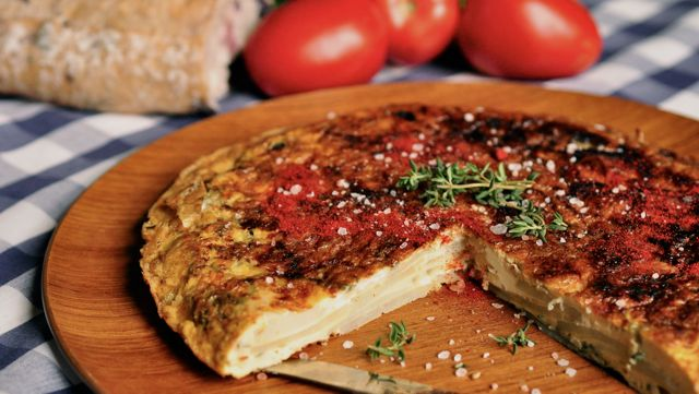 An image of a sliced Spanish tortilla