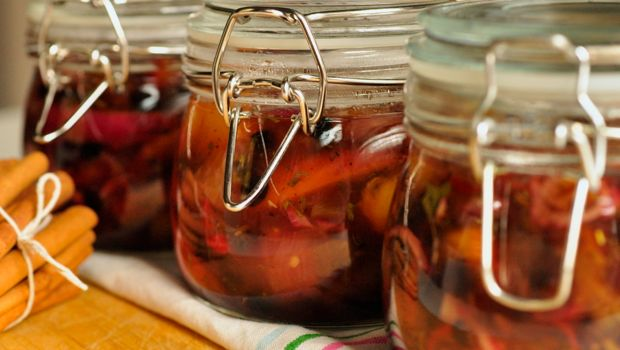 An image of finished jars of peach pickle