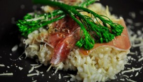 Risotto with prosciutto in a dark plate