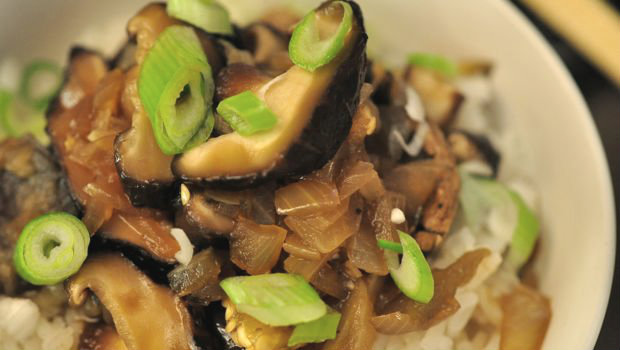 Close up of egg plant and mushroom stir fry Chinese dish