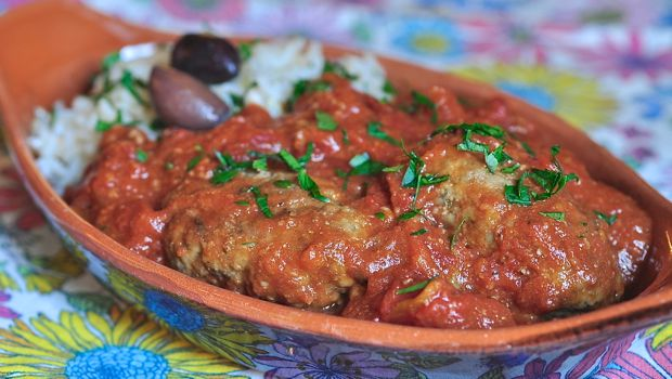 An image of Soutsoukakia - Greek meatballs with rice and tomato sauce