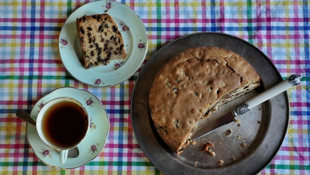 An image of Sultana cake with a cup of tea