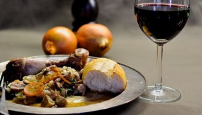 Coq au Vin with a glass of red wine