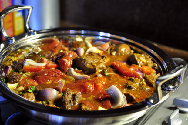 simmering beef tagine on a stove