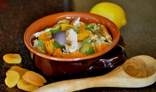 Moroccan cous cous with wooden spoon