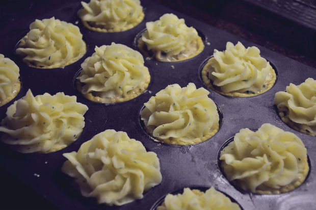 Australia Day mini Seafood pies with citrus mash topping in baking tray