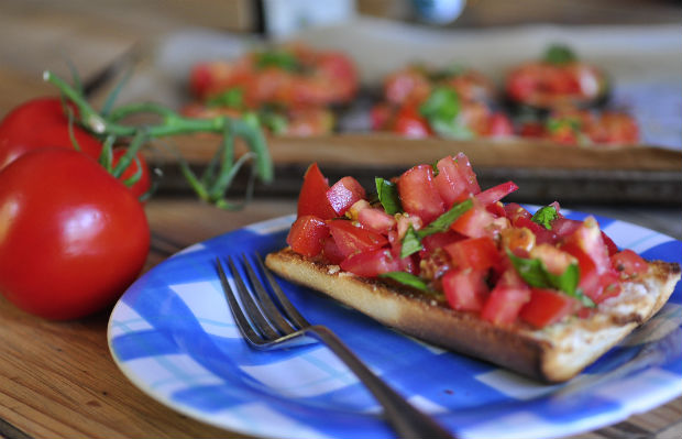 Tomato and fresh basil bruschetta on a blue plate