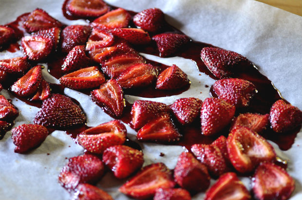 Roasted balsamic strawberries on a baking tray