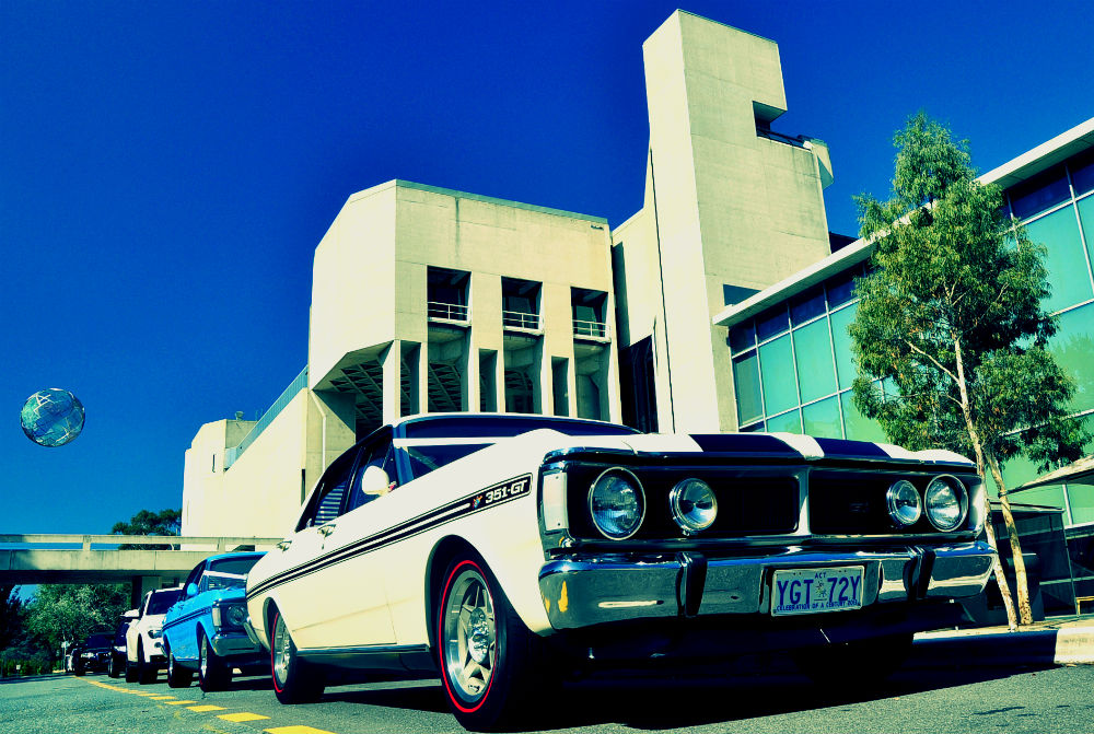 Vintage muscle cars parked in front of the AUstralian National Gallery, Canberra