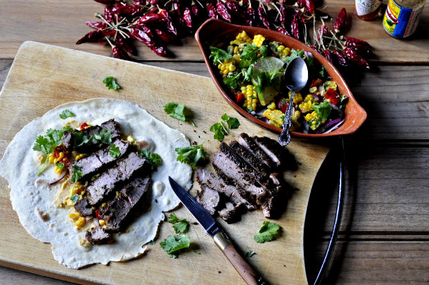 corn and lime salsa with chargrilled steak and tortillas on a board