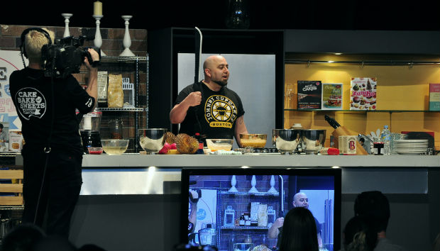 Duff Goldman with a machete at Cake Bake and Sweets 2014