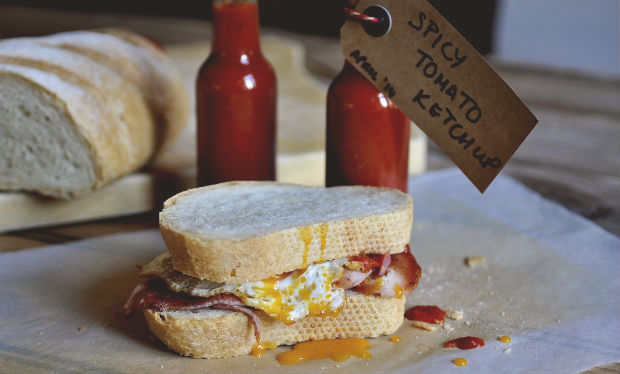 Spicy smoky tomato ketchup on bacon and egg sandwich