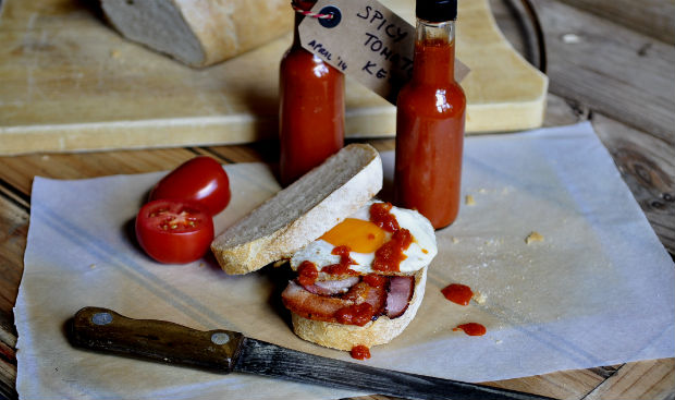 Spicy tomato ketchup on bacon sandwich with old knife
