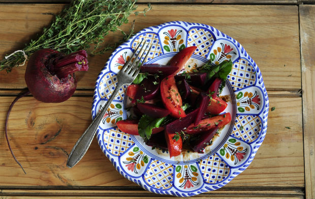 Beetroot and tomato salad with thyme and beet greens