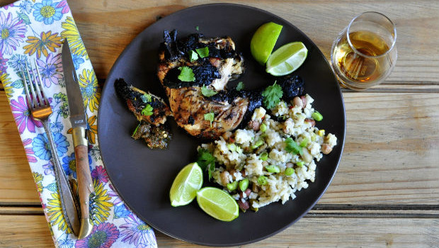 Perfect juicy, crispy, spicy jerk chicken on a plate
