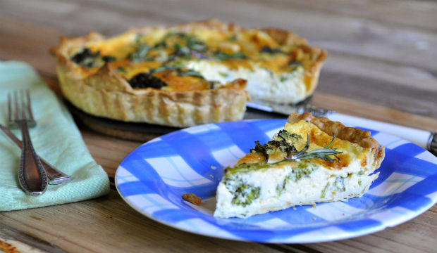 slice of broccolini and feta quiche on a plate