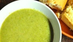 Bowl of homemade broccoli soup and fresh bread