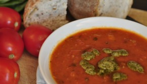Roast pepper and tomato soup close up in a bowl
