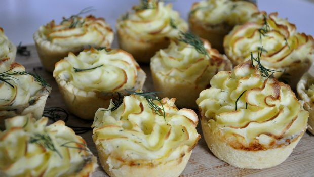 Baked mini seafood pies with citrus mash topping