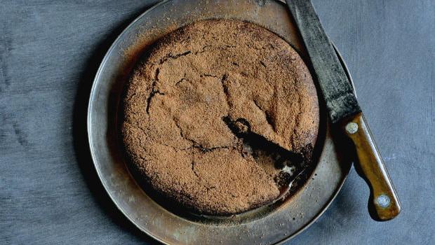 Flourless chocolate cake on a metal plate